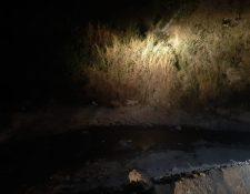 Los cuerpos fueron encontrados cerca de un río de aguas sucias. (Foto Prensa Libre: Andrea Domínguez)