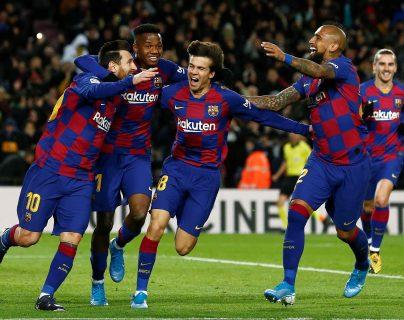 El delantero argentino Leo Messi (i), del FC Barcelona, celebra su gol durante el partido de la vigésima jornada. (Foto Prensa Libre: )