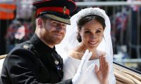 (FILES) In this file photo taken on May 19, 2018 Britain's Prince Harry, Duke of Sussex and his wife Meghan, Duchess of Sussex wave from the Ascot Landau Carriage during their carriage procession on the Long Walk as they head back towards Windsor Castle in Windsor, oafter their wedding ceremony. - Britain's Prince Harry and his wife Meghan will step back as senior members of the royal family and spend more time in North America, the couple said in a historic statement Wednesday. (Photo by Aaron Chown / POOL / AFP)