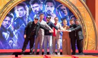 """(FILES) In this file photo taken on April 23, 2019 (From L-R) President of Marvel Studios/Producer Kevin Feige, actors  Chris Hemsworth, Chris Evans, Robert Downey Jr., Scarlett Johansson, Mark Ruffalo and Jeremy Renner attends the Marvel Studios' 'Avengers: Endgame' cast place their hand prints in cement at TCL Chinese Theatre IMAX Forecourt in Hollywood, California. - If streaming was meant to mark the demise of movie theaters, Disney did not get the memo. Theaters around the world took in an all-time record $42.5 billion last year, thanks largely to an unprecedented string of international mega-hits from the Mouse House such as """"Avengers: Endgame,"""" """"The Lion King"""" and """"Frozen II."""" (Photo by VALERIE MACON / AFP)"""