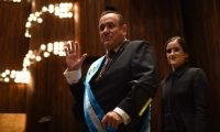 Guatemalan new President Alejandro Giammattei waves next to his daugther Marcela after his inauguration ceremony at the National Theater, in Guatemala City, on January 14, 2020. - The doctor right-wing Alejandro Giamattei assumes as president of Guatemala in replacement of the unpopular Jimmy Morales, with the promise of attacking corruption and contain the high levels of poverty. (Photo by Johan ORDONEZ / AFP)