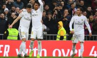 Real Madrid's Brazilian midfielder Casemiro (C) celebrates his goal with Real Madrid's Serbian forward Luka Jovic (L) and Real Madrid's Spanish forward Lucas Vazquez during the Spanish league football match between Real Madrid CF and Sevilla FC at the Santiago Bernabeu stadium in Madrid on January 18, 2020. (Photo by GABRIEL BOUYS / AFP)