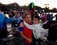 "TOPSHOT - Central American migrants -mostly Hondurans heading in a caravan to the US- cross the Suchiate River from Tecun Uman, Guatemala, to Ciudad Hidalgo, Chiapas State, Mexico, on January 23, 2020. - Mexican migration authorities released Wednesday an official count of the number of people detained along the country's southern border two days before, estimating that more than 2,000 people were ""rescued"" after they crossed the border with Guatemala. (Photo by ALFREDO ESTRELLA / AFP)"