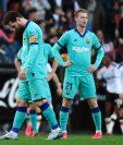 Messi se lamenta en el partido contra el Valencia. (Foto Prensa Libre: AFP)