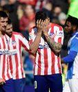 Los jugadores del Atlético de Madrid se lamentan el empate conseguido. (Foto Prensa Libre: AFP)