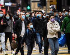 Miles de ciudadanos en China utilizan mascarillas para protegerse de varias enfermedades. (Foto Prensa Libre: AFP)