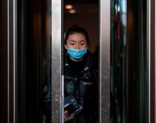 A passenger from China's Hainan Airlines flight HU7925 from Beijing walks out of the arrivals gate at the Abelardo L. Rodriguez International airport in Tijuana, Mexico, on January 27, 2020. - China's capital on Monday recorded its first death from a deadly coronavirus as it struggles to contain a rapidly spreading disease that has sparked global alarm, with countries scrambling to evacuate their citizens from the epicentre of the epidemic. (Photo by Guillermo Arias / AFP)