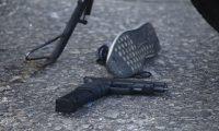 Una de las armas que quedó tirada en el lugar de la balacera en la zona 6. (Foto Prensa Libre: PNC).