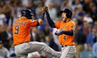 (FILES) In this file photo George Springer #4 of the Houston Astros celebrates with Marwin Gonzalez #9 after hitting a two-run home run during the second inning against the Los Angeles Dodgers in game seven of the 2017 World Series at Dodger Stadium on November 1, 2017 in Los Angeles. - The Houston Astros said Tuesday the team was cooperating with a Major League Baseball investigation into allegations the team illegally stole signs during their 2017 World Series-winning campaign. (Photo by EZRA SHAW / GETTY IMAGES NORTH AMERICA / AFP)