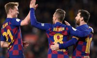 Barcelona's Brazilian midfielder Arthur celebrates scoring his team's fourth goal with Barcelona's Dutch midfielder Frenkie De Jong (L) and Barcelona's Argentine forward Lionel Messi during the Copa del Rey (King's Cup) football match between FC Barcelona and Club Deportivo Leganes SAD at the Camp Nou stadium in Barcelona, on January 30, 2020. (Photo by Josep LAGO / AFP)