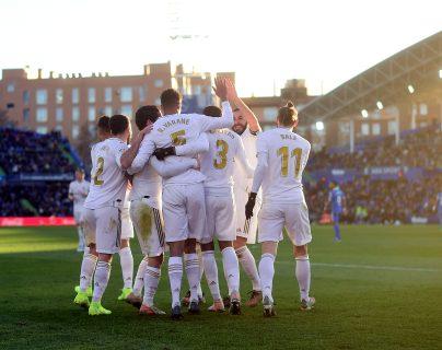 Los jugadores del Real Madrid celebraron en la casa del Getafe. (Foto Prensa Libre: AFP)