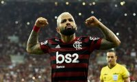 """(FILES) In this file photo taken on October 23, 2019 Flamengo's Gabriel Barbosa celebrates after scoring against Gremio during their Copa Libertadores second leg semi-final football match, at Maracana stadium in Rio de Janeiro, Brazil. - Gabriel Barbosa, aka """"Gabigol,"""" announced on January 28, 2020 that he is staying in Flamengo after several months of speculation about his future. (Photo by MAURO PIMENTEL / AFP)"""