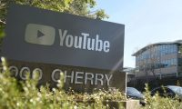 "(FILES) In this file photo taken on April 3, 2018, a YouTube sign is seen at YouTube's corporate headquarters  in San Bruno, California. - YouTube broadened its anti-harassment policies on December 11, 2019, to include a ban on ""implied"" threats along with insults based on race, gender identity or sexual orientation. ""We will no longer allow content that maliciously insults someone based on protected attributes such as their race, gender expression, or sexual orientation,"" global head of trust and safety Matt Halprin said in an online post. (Photo by JOSH EDELSON / AFP)"