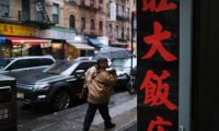 NEW YORK, NEW YORK - FEBRUARY 13: People walk through New York's Chinatown on February 13, 2020 in New York City. Gregg Bishop, commissioner of the Department of Small Business Services in New York, has said that revenues are down around 40% in Chinatown as fears continue over the coronavirus. There are no confirmed coronavirus cases in New York City and the city is urging people to visit Chinatown to shop and dine.   Spencer Platt/Getty Images/AFP == FOR NEWSPAPERS, INTERNET, TELCOS & TELEVISION USE ONLY ==