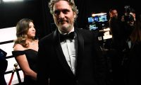 """In this handout photo provided by A.M.P.A.S. Best Actor award winner Joaquin Phoenix  stands backstage during the 92nd Annual Academy Awards at the Dolby Theatre on February 09, 2020 in Hollywood, California. (Photo by Richard Harbaugh / AMPAS / AFP) / RESTRICTED TO EDITORIAL USE - MANDATORY CREDIT """"AFP PHOTO / AMPAS/ Richard Harbaugh """" - NO MARKETING - NO ADVERTISING CAMPAIGNS - DISTRIBUTED AS A SERVICE TO CLIENTS"""