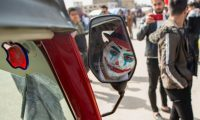 An Iraqi demonstrator dressed in a Joker outfit poses for a picture inside as he sits inside a Tuk-Tuk during an anti-government demonstration by Basra University students in the southern city of Basra, on February 11, 2020. - Mass rallies have rocked Baghdad and the mainly-Shiite south since October, with protesters demanding snap elections and an independent prime minister as well as accountability for corruption and recent bloodshed. (Photo by Hussein FALEH / AFP)