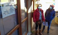 "People   wearing protective face masks as a safety measure against COVID-19, the novel coronavirus, stand next to a sign reading ""Coronavirus, as a precautionary measure, the entirety of municipal buildings are closed to the public"", on February 28, 2020, in La Balme-de-Sillingy, central-eastern France, where two new coronarivus cases where detected, adding to the four already found the town. - The town's mayor announced the new cases on February 28, saying he feared more contaminations. The six patients - all hospitalised in Annecy - ""took part on February 15 in a campaign meeting that gathered 120 people in the neighbouring town of Mesigny,"" the mayor told AFP. (Photo by Maxime PETIT / AFP)"
