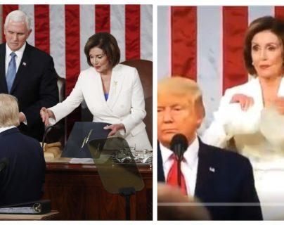 Donald Trump ignora el saludo de Pelosi (izquierda). Momento en que la demócrata rompe el discurso del mandatario. (Foto: EFE/AFP)