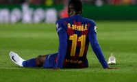 (FILES) In this file photo taken on November 27, 2019 Barcelona's French forward Ousmane Dembele sits on the ground after an injury during the UEFA Champions League Group F football match between FC Barcelona and Borussia Dortmund at the Camp Nou stadium in Barcelona, on November 27, 2019. - French international forward Ousmane Dembele has suffered a badly torn hamstring, his club Barcelona announced on February 4, 2020. The 22-year-old has struggled with hamstring problems. He had only just returned to training from an injury to the right thigh he suffered in November before suffering a fresh problem in training. (Photo by Josep LAGO / AFP)