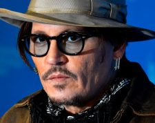 """(FILES) In this file photo taken on February 21, 2020 US actor Johnny Depp poses during a photocall for the film """"Minamata"""" screened in the Berlinale Special Gala on February 21, 2020 at the 70th Berlinale film festival in Berlin. - Hollywood star Johnny Depp made a surprise appearance at England's High Court on February 26, 2020 for a hearing in his libel case against The Sun newspaper. (Photo by John MACDOUGALL / AFP)"""