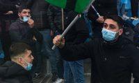 Genoa (Italy), 23/02/2020.- Lazio'Äôs fans wearing a protective face mask due to the 'Coronavirus' epidemic before the Italian Serie A soccer match Genoa Cfc vs Ss Lazio at Luigi Ferraris stadium in Genoa, Italy, 23 February 2020. (Italia, Génova) EFE/EPA/SIMONE ARVEDA