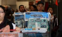 NOVATO, CALIFORNIA - MARCH 14: Customers push shopping carts filled with supplies at a Costco store on March 14, 2020 in Novato, California. Some Americans are stocking up on food, toilet paper, water and other items after the World Health Organization (WHO) declared Coronavirus (COVID-19) a pandemic.   Justin Sullivan/Getty Images/AFP == FOR NEWSPAPERS, INTERNET, TELCOS & TELEVISION USE ONLY ==