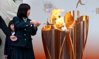 Fukushima (Japan), 24/03/2020.- A school student lights the 'Fire of Recovery' for the Tokyo 2020 Olympic Torch exhibition in Fukushima, Japan, 24 March 2020. According to reports, Japanese prime minister Shinzo Abe and International Olympic Committee (IOC) president Thomas Bach agreed to postpone the Tokyo 2020 Olympics for one year due to the coronavirus COVID19 pandemic. (Incendio, Japón, Tokio) EFE/EPA/JIJI PRESS JAPAN OUT EDITORIAL USE ONLY/ NO ARCHIVES
