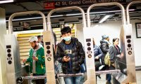 A man wears a face mask as he arrives to take the subway on March 8, 2020 in New York City. - The governor of New York on March 7, 2020 announced a state of emergency as the coronavirus continued to spread in the northeastern state, with 21 new cases. A total of 76 people have so far tested positive for the virus, Governor Andrew Cuomo told reporters in the state capital of Albany. Ten of those affected have been hospitalized. (Photo by Kena Betancur / AFP)
