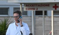 Italian doctor Massimo Fantoni speaks on his mobile phone outside the newly built Columbus Covid 2 temporary hospital to fight the new coronavirus infection, on March 16, 2020 at the Gemelli hospital in Rome. (Photo by ANDREAS SOLARO / AFP)