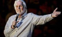 (FILES) This file photo taken on March 19, 2017 shows US singer Kenny Rogers performing in concert on his 'Farewell Tour' during Rodeo Austin at the Travis County Expo Center in Austin, Texas. - Country music legend Kenny Rogers, whose career spanned six decades, has died at the age of 81, his family said late on March 20, 2020. (Photo by SUZANNE CORDEIRO / AFP)