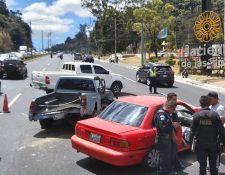 El accidente en el km 14 de la ruta al Pacífico complica el tránsito en Villa Nueva y Mixco. (Foto Prensa Libre: PMT Villa Nueva)