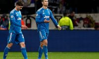 Lyon (France), 26/02/2020.- Cristiano Ronaldo (R) of Juventus and teammate Federico Bernardeschi (L) react after the UEFA Champions League round of 16 first leg soccer match between Olympique Lyon and Juventus FC in Lyon, France, 26 February 2020. (Liga de Campeones, Francia) EFE/EPA/GUILLAUME HORCAJUELO
