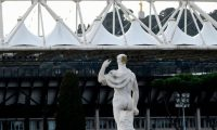 A photo taken on March 17, 2020 shows the Olympic stadium in Rome, with a statue from the Marbles stadium (Stadio dei Marmi) in foreground. - The European EURO 2020 football championship, due to be played in June and July this year with its opening game and three others at the Olympic stadium in Rome, has been postponed until 2021 because of the coronavirus pandemic, European football's governing body UEFA said on March 17. (Photo by Filippo MONTEFORTE / AFP)