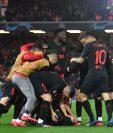 Así festejaron los jugadores del Atlético en Anfield. (Foto Prensa Libre: AFP)