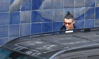 (FILES) In this file photo taken on March 03, 2020 Juventus' Portuguese forward Cristiano Ronaldo gets into a car upon his arrival at Madeira airport in Funchal on March 3, 2020. - Portuguese football star Cristiano Ronaldo remains confined to his home in Madeira after Juventus teammate Daniele Rugani tested positive for the new coronavirus, but has no symptoms, regional authorities in Madeira said on March 22, 2020. (Photo by RUI SILVA / AFP)