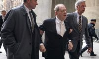 """(FILES) In this file photo taken on January 23, 2020 Harvey Weinstein arrives at Manhattan Supreme Court for the second day in his rape and sexual assault trial. - Disgraced former movie mogul Harvey Weinstein was taken to New York's notorious Rikers Island jail on March 5, 2020, ten days after he was convicted of rape and sexual assault. The 67-year-old """"Pulp Fiction"""" producer had been in a Manhattan hospital since his landmark conviction on February 24 after he complained of chest pains following the verdict. (Photo by TIMOTHY A. CLARY / AFP)"""