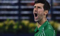 Novak Djokovic of Serbia celebrates after winning the final of the Dubai Duty Free Tennis Championship in the Gulf emirate of Dubai on February 29, 2020. (Photo by KARIM SAHIB / AFP)