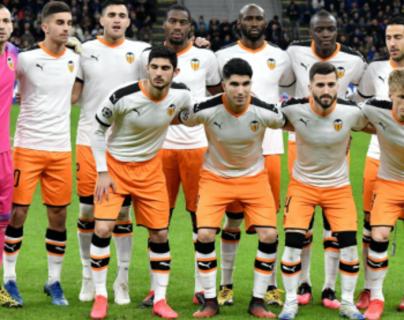 Este el once inicial que disputó el partido de vuelta de octavos de final entre el Valencia y el Atalanta. (Foto Prensa Libre: AFP)
