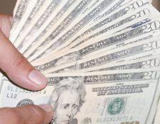 Este lunes el mercado cambiario registró una extraordinaria demanda que presionó la cotización del dólar frente al quetzal, atribuido en parte por la emergencia del covid-19, confirmaron las autoridades monetarias. (Foto Prensa Libre: Hemeroteca)
