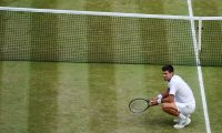 Wimbledon (United Kingdom).- (FILE) Novak Djokovic of Serbia celebrates winning against Roger Federer of Switzerland during their Men's final match for the Wimbledon Championships at the All England Lawn Tennis Club, in London, Britain, 14 July 2019. According to reports on 20 April 2020, 17-time Grand Slam champion Djokovic's opposition to vaccination may stop his return to the tennis tour. (Tenis, Suiza, Reino Unido, Londres) EFE/EPA/WILL OLIVER EDITORIAL USE ONLY/NO COMMERCIAL SALES *** Local Caption *** 55991474