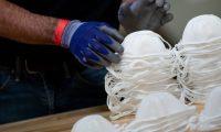 A worker at a Honeywell International Inc. factory producing N95 masks May 5, 2020, in Phoenix, Arizona. (Photo by Brendan Smialowski / AFP)