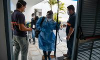 Journalits are disinfected by Health workers before a press conference given by Doctors and health workers at Villa Nueva hospital, the main institution assigned to assist COVID-19 patiens, in Villa Nueva, Guatemala on May 14, 2020. - Doctors announced that after negotiations, the Ministry of Health offered to hire more specialists and guaranteed the supply of protective equipment. (Photo by Johan ORDONEZ / AFP)