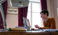 (FILES) In this file photo taken on March 17, 2020 (FILES) In this file photo taken on March 17, 2020 Geraldine Leforestier works at home as her children homeschool while the schools are closed  in Mulhouse, eastern France amid spread of novel coronavirus (COVID-19). - An explosion in remote working owing to the coronavirus pandemic could see companies slash office space, saving them money but not necessarily improving productivity among staff, according to experts. Businesses allowing staff to work from home on a permanent basis, even as lockdowns ease worldwide, places into question the future of skyscrapers used by multinationals and which are seen as symbols of modern capitalism. (Photo by SEBASTIEN BOZON / AFP) / TO GO WITH AFP STORY BY JEAN-BAPTISTE OUBRIER