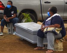 Women wait to bury a loved one at the Caminos del Cielo cemetery in Managua on May 23, 2020 during the COVID-19 novel coronavirus pandemic. - The pandemic has killed at least 339,758 people worldwide since it surfaced in China late last year, according to an AFP tally at 1900 GMT on Saturday based on official sources. (Photo by ISIDRO HERNANDEZ / AFP)