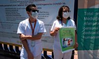 "Medical personnel from different institutions including the National Institute of Respiratory Diseases (INER) protest against the shortage of protection gear with a sign reading ""The presonal protective equipment is not a game,"" amid the new coronavirus pandemic in Mexico City on May 25, 2020. (Photo by Alfredo ESTRELLA / AFP)"