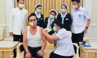 "This handout from the Royal Thai Government taken and released on May 26, 2020 shows Thailand's Prime Minister Prayut Chan-O-Cha (front L) receiving an influenza vaccine injection in Bangkok, as Health Minister Anutin Charnvirakul (back L) watches. (Photo by Handout / ROYAL THAI  GOVERNMENT / AFP) / -----EDITORS NOTE --- RESTRICTED TO EDITORIAL USE - MANDATORY CREDIT ""AFP PHOTO / ROYAL THAI GOVERNMENT"" - NO MARKETING - NO ADVERTISING CAMPAIGNS - DISTRIBUTED AS A SERVICE TO CLIENTS"