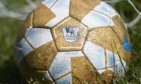 London (United Kingdom).- (FILE) - A football with the logo of the English Premier League is seen at the training complex of Watford FC in Hertfordshire, London Colney, north London, Britain, 18 May, 2020 (re-issued on 27 May 2020). On 27 May 2020 Premier League released a statement announcing that 'Squads are now able to train as a group and engage in tackling while minimising any unnecessary close contact'. 'Strict medical protocols are in place to ensure the training ground is the safest environment possible and players and staff will continue to be tested for COVID-19 twice a week'. (Reino Unido, Londres) EFE/EPA/ANDY RAIN *** Local Caption *** 56093702