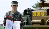 """This handout photo taken on May 8, 2020 and published on the official Facebook page of the Republic of Korea Marine Corps shows Tottenham Hotspur's South Korean striker Son Heung-min in military uniform posing with a prize during a basic military training completion ceremony at a marines boot camp in Jeju island. - Tottenham Hotspur striker Son Heung-min was named one of the top five recruits in his unit as he finished three weeks of compulsory military training in South Korea on May 8. (Photo by Handout / Republic of Korea Marine Corps / AFP) / RESTRICTED TO EDITORIAL USE - MANDATORY CREDIT """"AFP PHOTO / Republic of Korea Marine Corps"""" - NO MARKETING NO ADVERTISING CAMPAIGNS - DISTRIBUTED AS A SERVICE TO CLIENTS"""