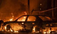 """MINNEAPOLIS, MN - MAY 27: A car burns near the Third Police Precinct on May 27, 2020 in Minneapolis, Minnesota. A number of businesses and homes were damaged as the area has become the site of an ongoing protest after the police killing of George Floyd. Four Minneapolis police officers have been fired after a video taken by a bystander was posted on social media showing Floyd's neck being pinned to the ground by an officer as he repeatedly said, """"I cant breathe"""". Floyd was later pronounced dead while in police custody after being transported to Hennepin County Medical Center.   Stephen Maturen/Getty Images/AFP == FOR NEWSPAPERS, INTERNET, TELCOS & TELEVISION USE ONLY =="""