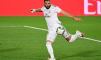 Real Madrid's French forward Karim Benzema eyes on the ball prior to shooting and scoring his second goal during the Spanish league football match between Real Madrid CF and Valencia CF at the Alfredo di Stefano stadium in Valdebebas, on the outskirts of Madrid, on June 18, 2020. (Photo by JAVIER SORIANO / AFP)